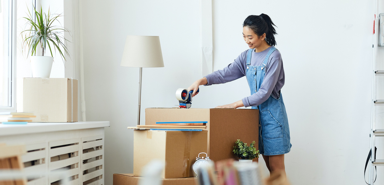 Woman packing up boxes and organizing home