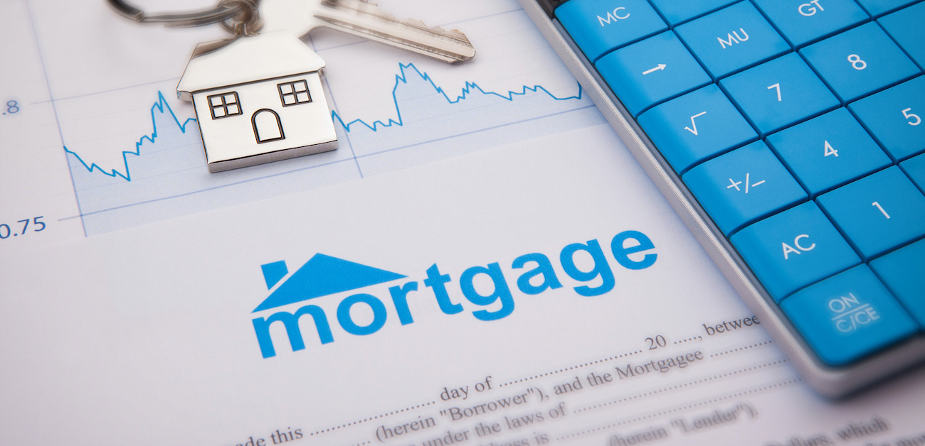 Mortgage applicatio with calculator and key
