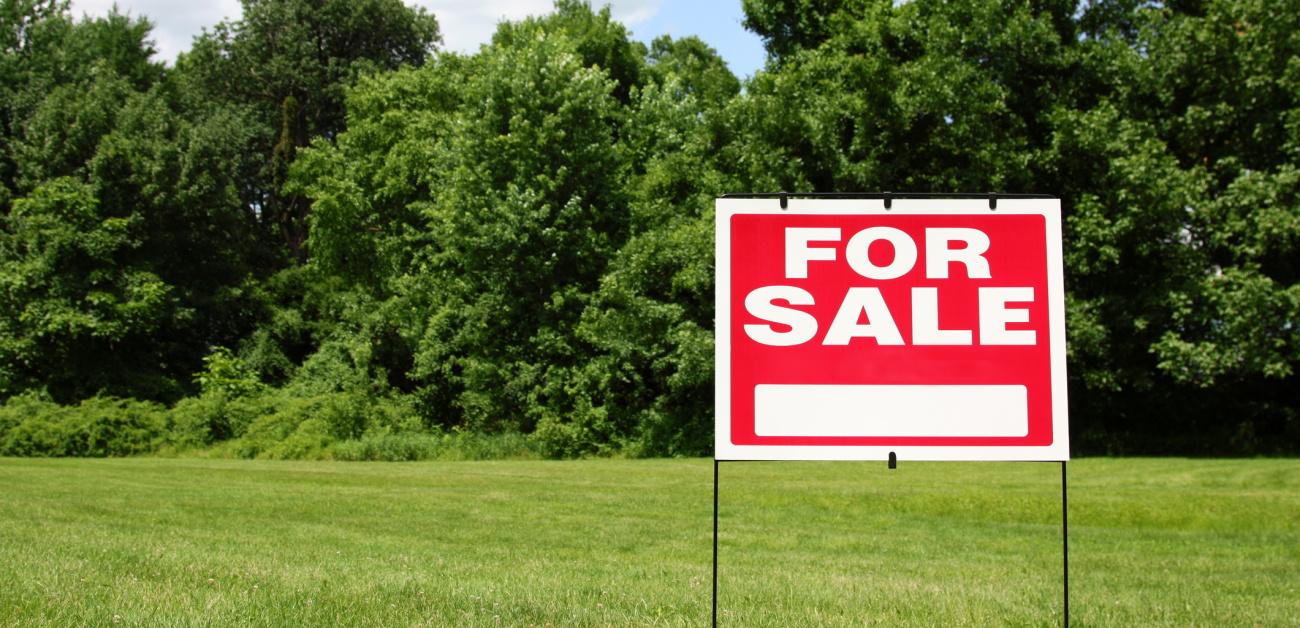 Open property with a For Sale sign
