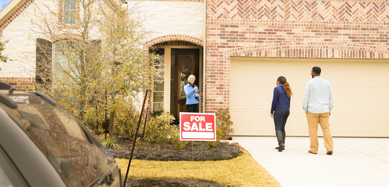 Couple meeting agent to look at home for sale