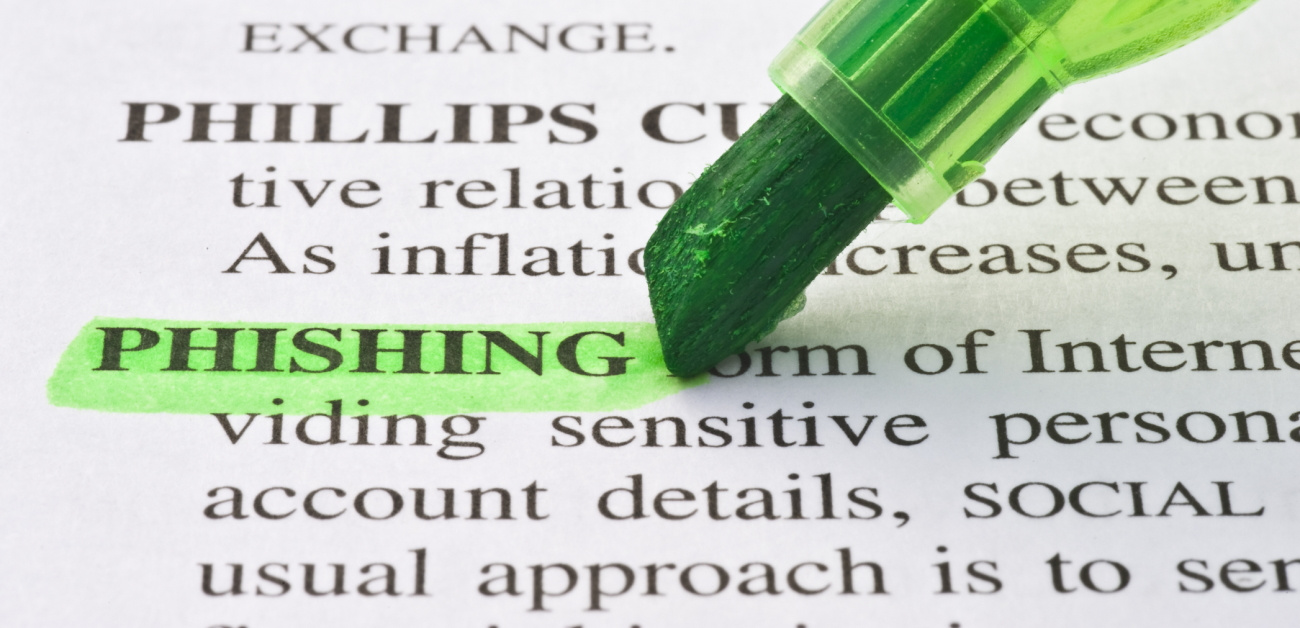 """The word """"Phishing"""" highlighted in green on a printed page"""
