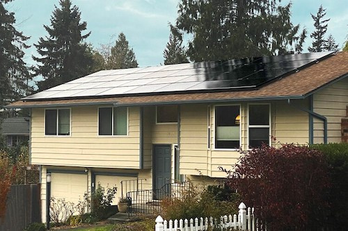 Yellow house with solar panels