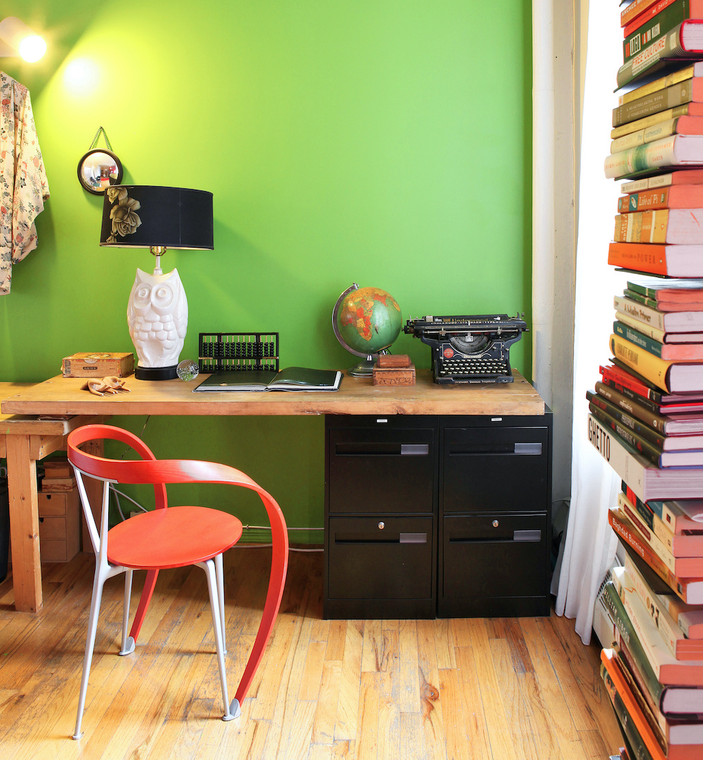 Complementary reds and greens in a personal home office.