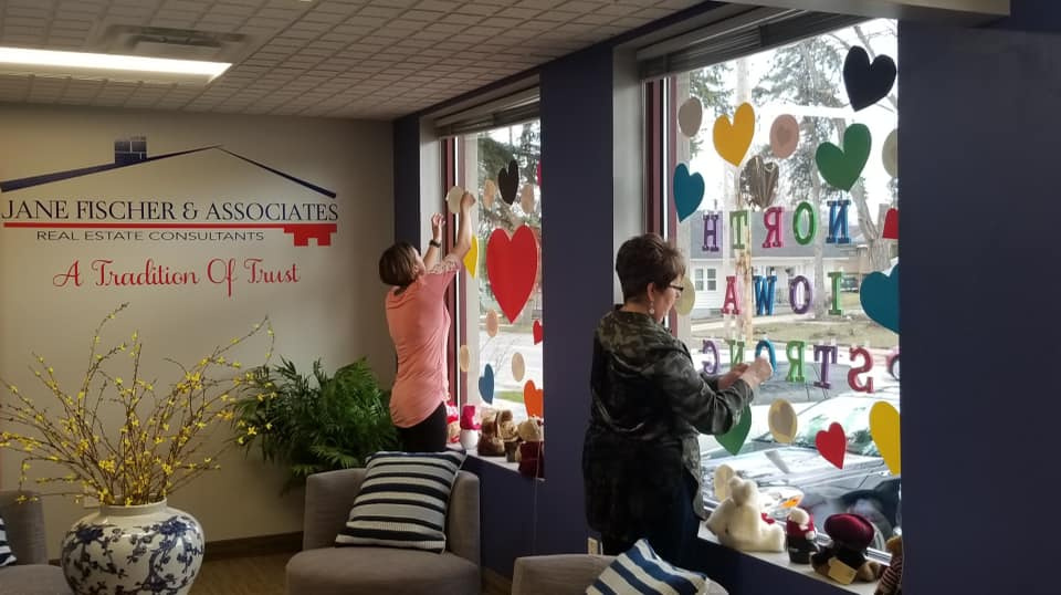 agent decorating their brokerage window