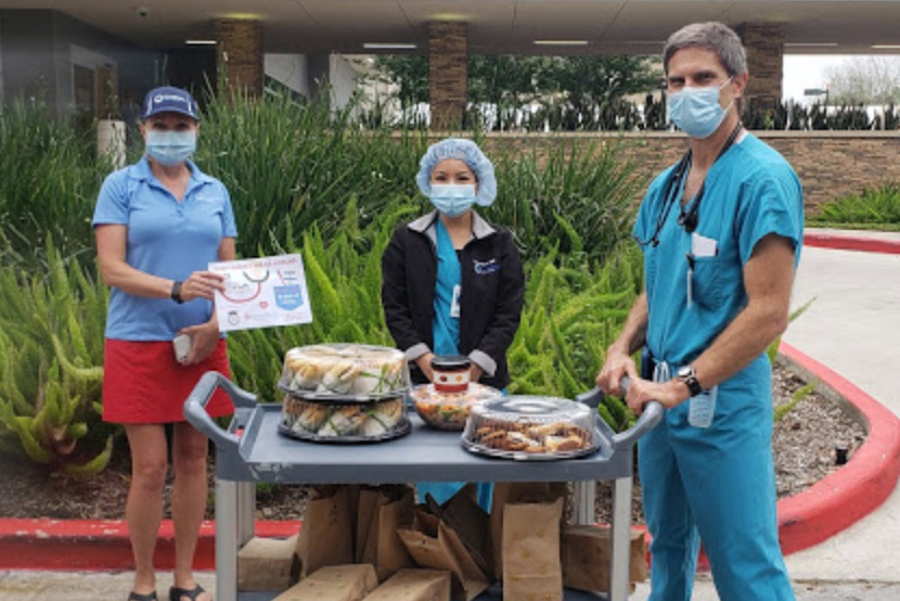 health care professionals receiving donated meals