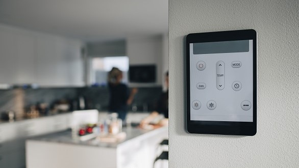 Touchscreen thermostat on kitchen wall