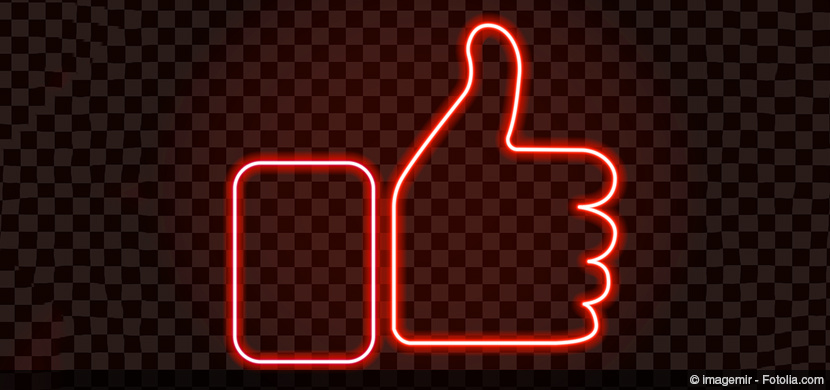 Thumbs up in red neon