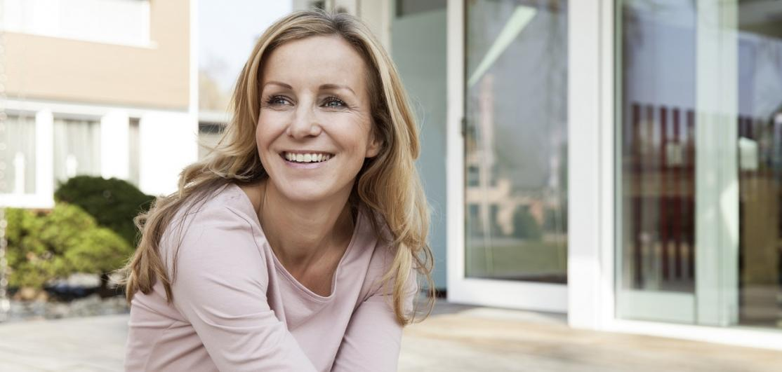 Smiling woman sitting on terrace