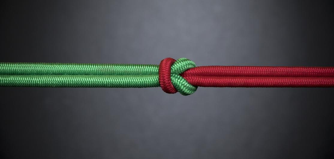 Red and green rope knotted together