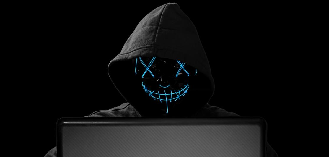 hacker with glowing mask