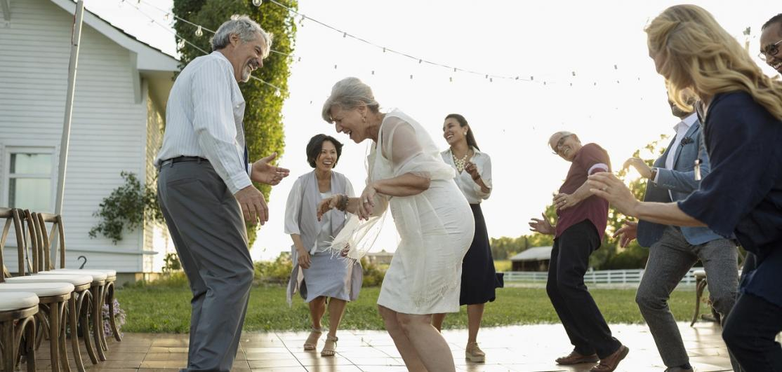 Seniors dancing with friends