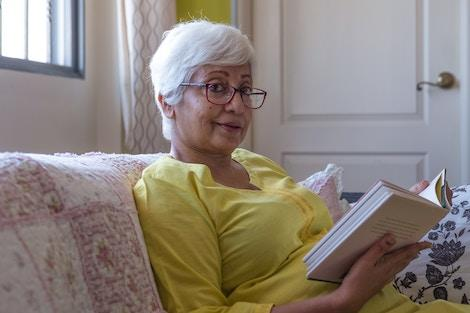 Senior woman sitting in home