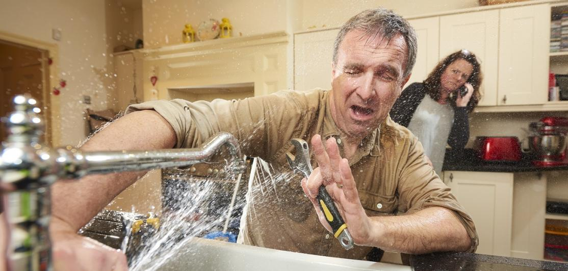 Handyman sprayed by faucet