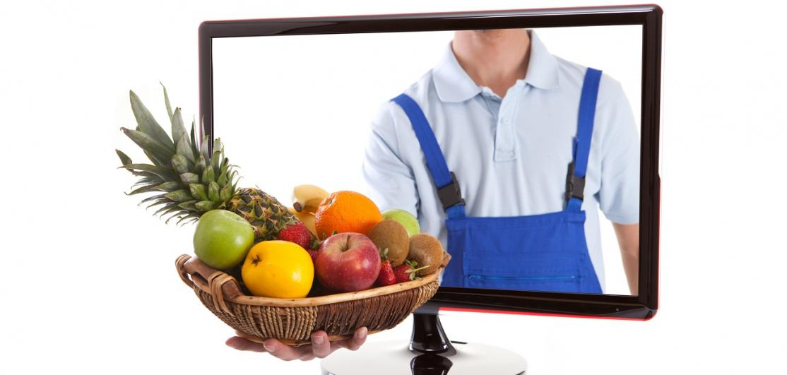 Farmer is holding fruit basket in computer