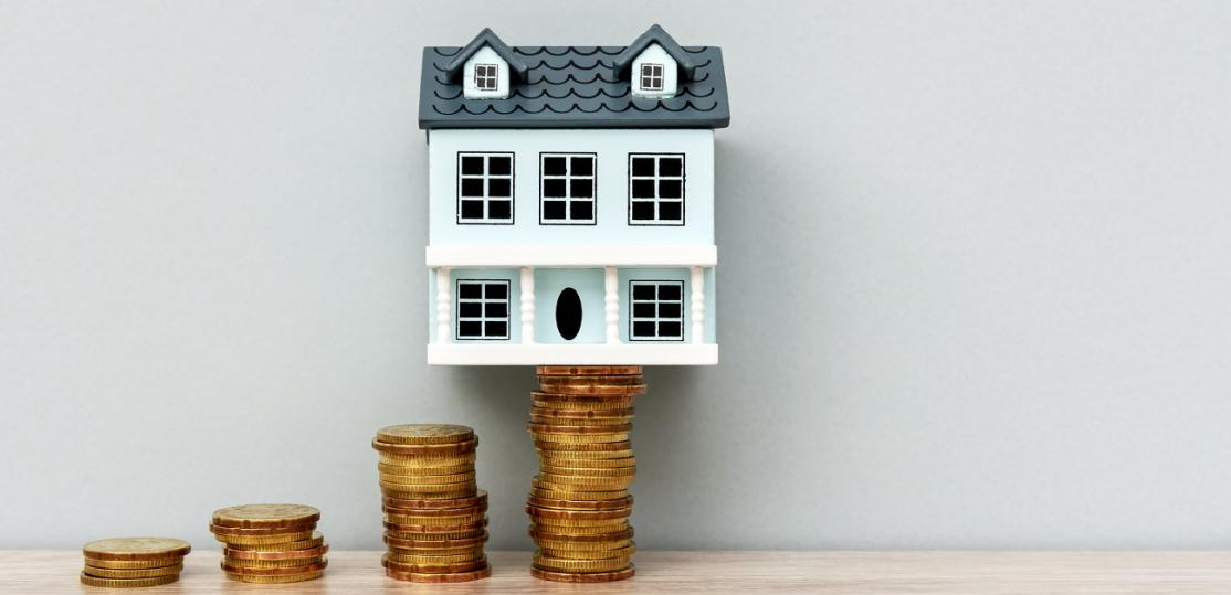 House Model on Top of Stack of Coins