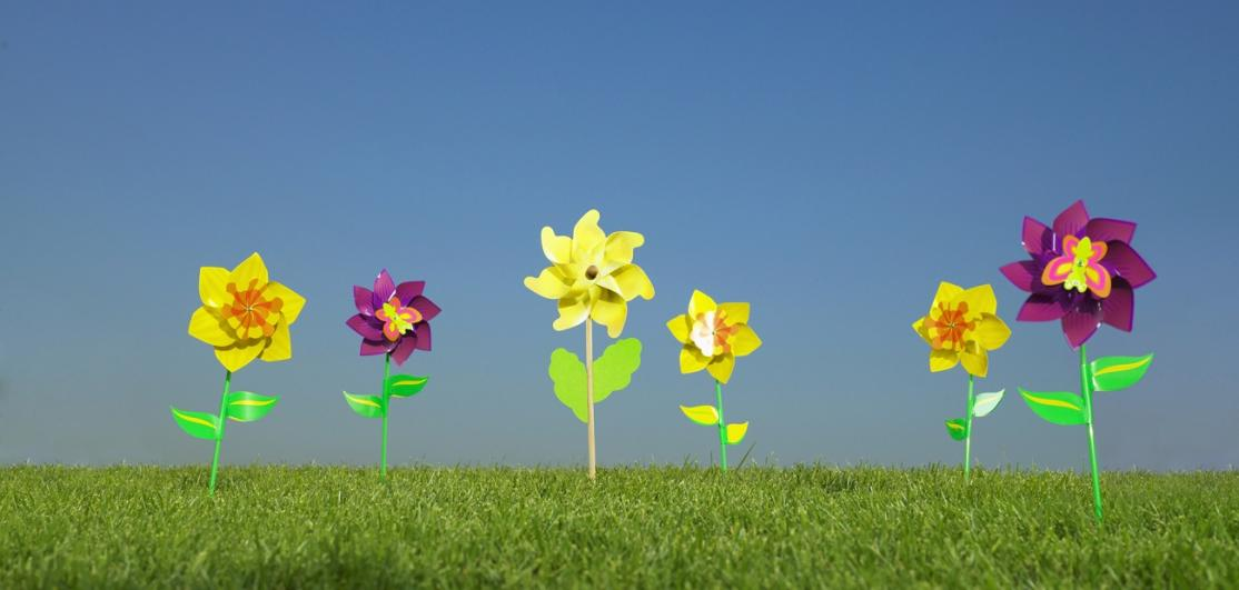 Fake flowers planted in synthetic grass