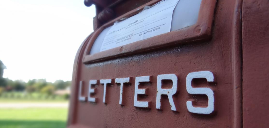"A mailbox with the text ""LETTERS"""