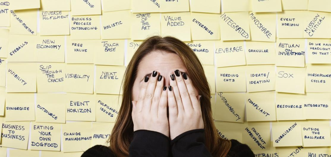 woman hides from excess of business buzzwords