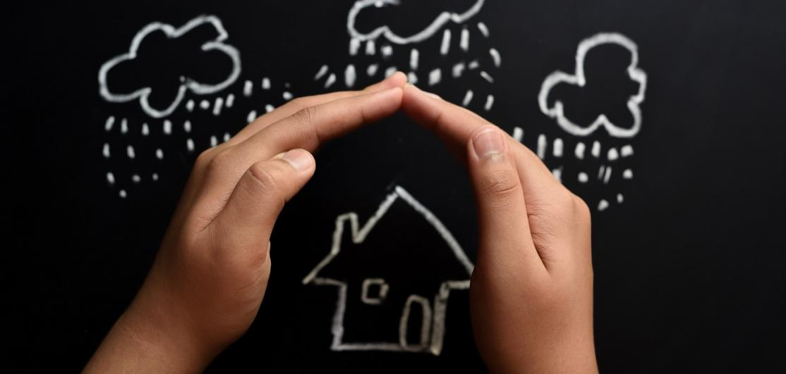 Concept of homeowners insurance on blackboard in chalk