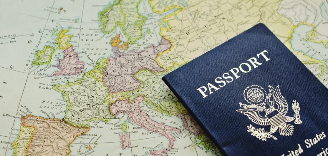 Passport on a map of the world