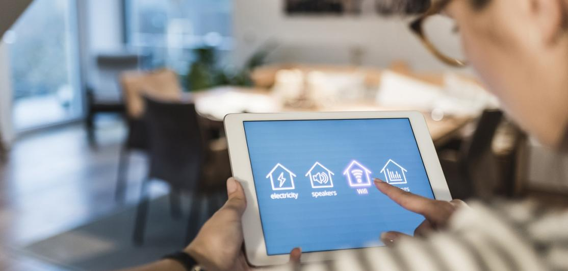 Woman operating smart-home gadgets
