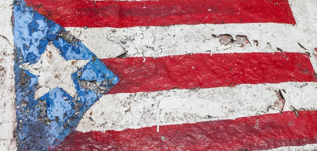 Puerto Rican flag painted on rock
