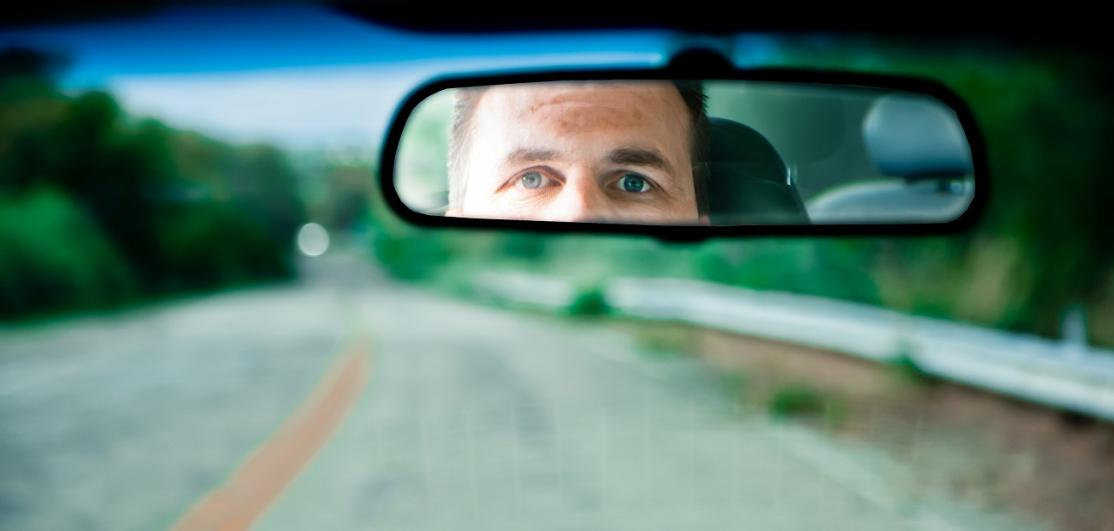 Driver looking into rearview mirror