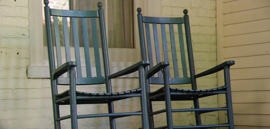 A pair of rocking chairs on a porch