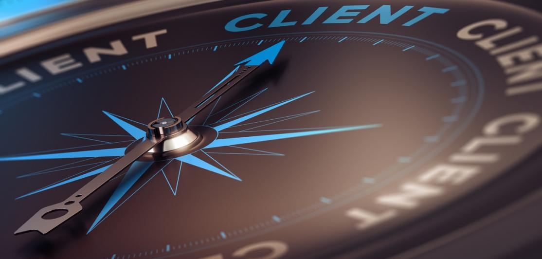 Compass with needle pointing to the word client