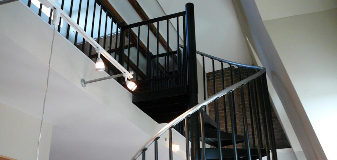 A spiral staircase leading to a second floor