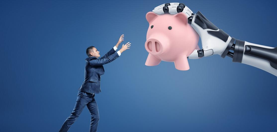 A tiny businessman loses a large pink piggy bank to a giant robotic hand.