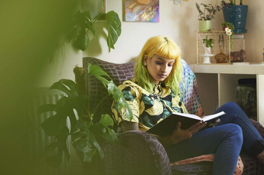 Young adult reading in apartment