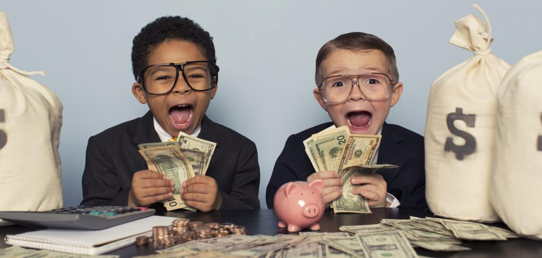 Two Young Children Holding Lots of Money