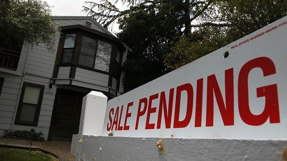 Home with sale-pending sign