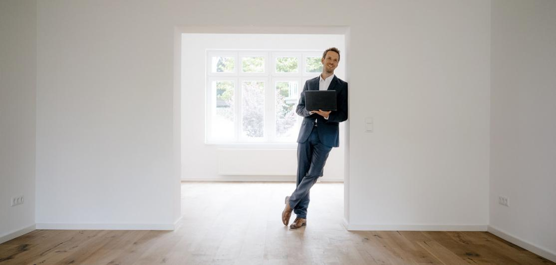Real estate agent waiting in newly refurbished home