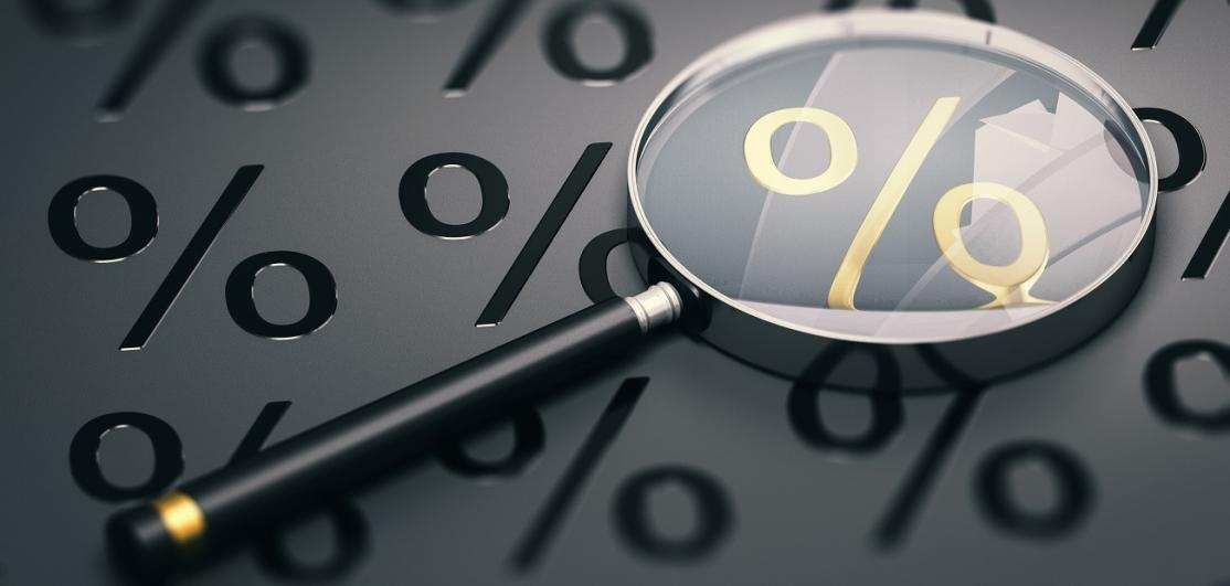 Magnifying glass on percent sign