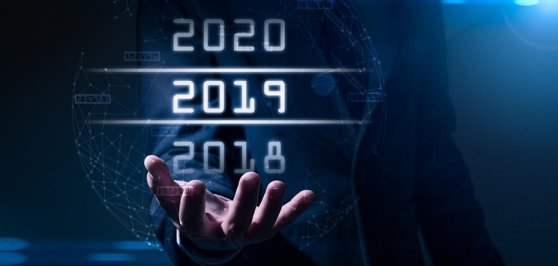 businessman points to futuristic years hologram