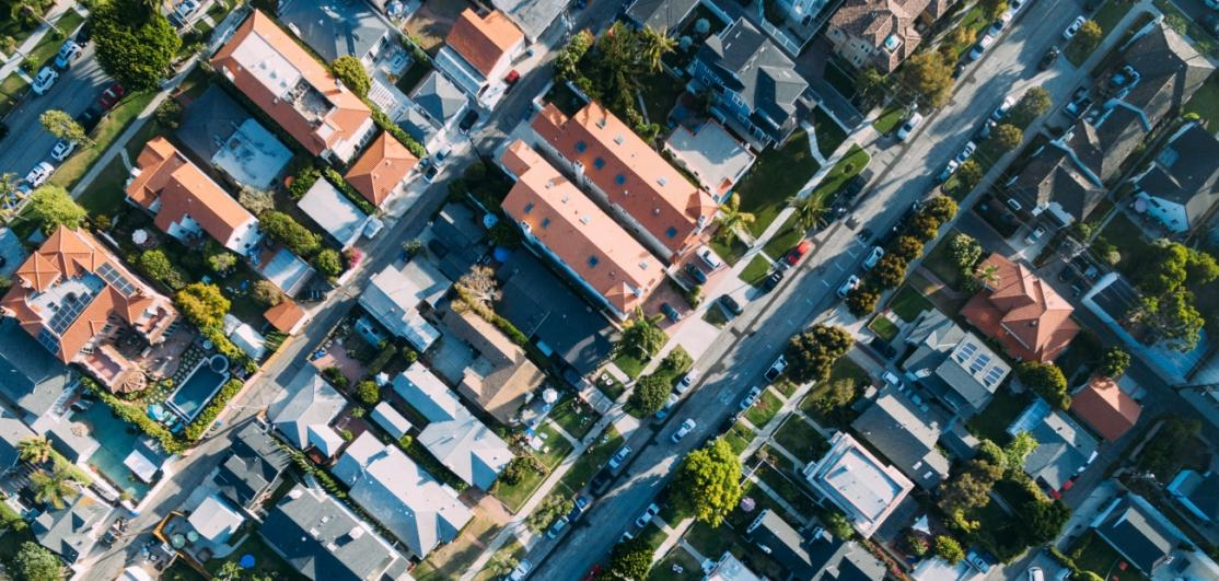 An overhead view of city streets and homes.