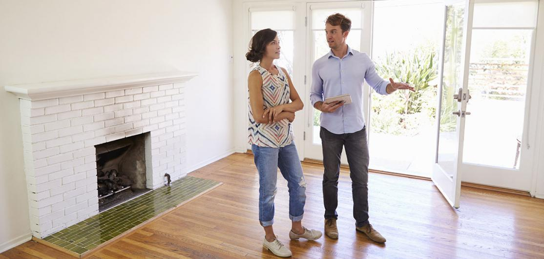 Agent Showing speaking to Client at House