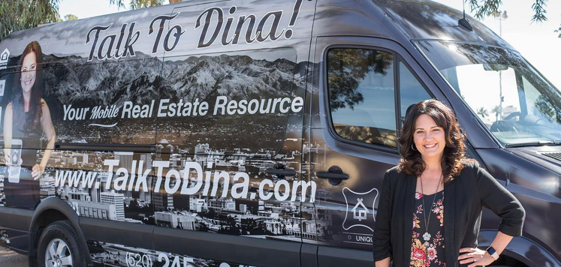 Dina Hogg in front of her mobile office