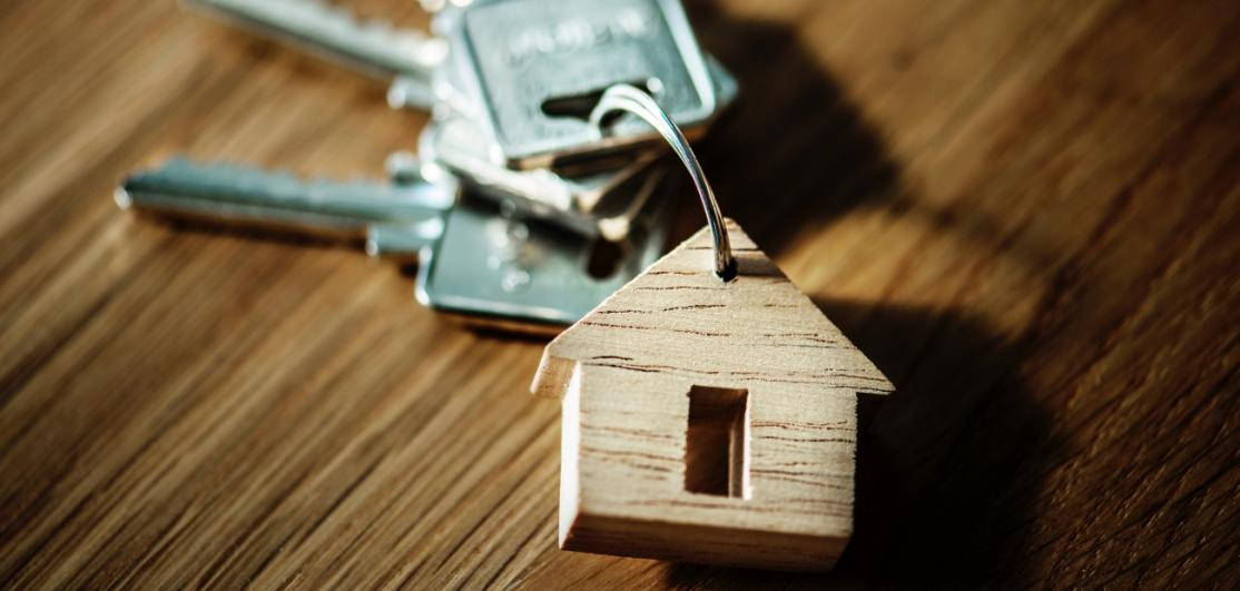 A keychain in the shape of a home.