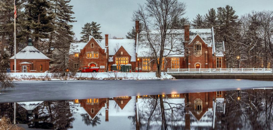 A snow-topped mansion on a lake