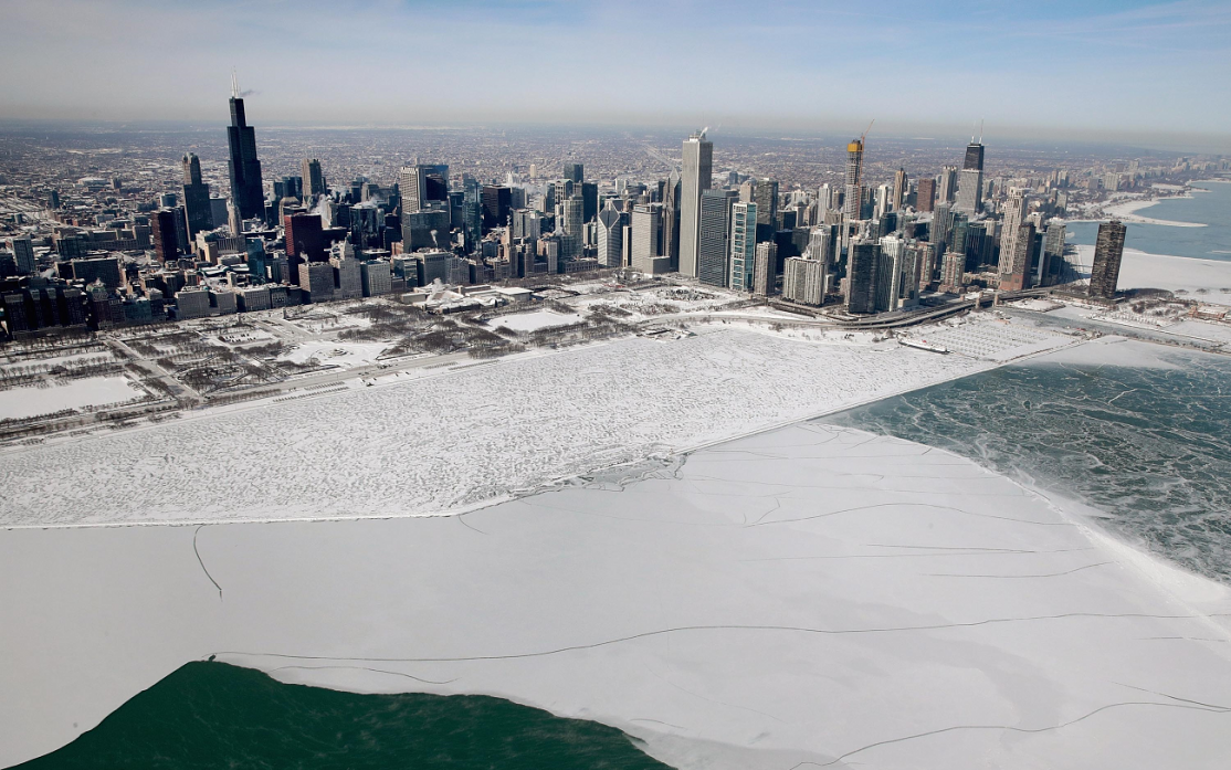 Chicago skyline in back of ice-covered Lake Michican
