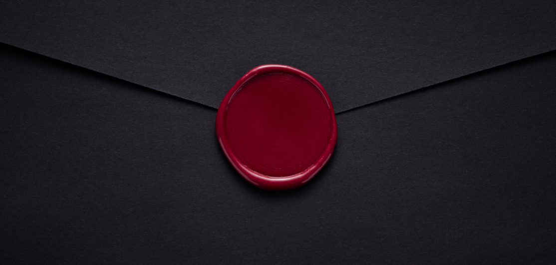 Black envelope with red seal
