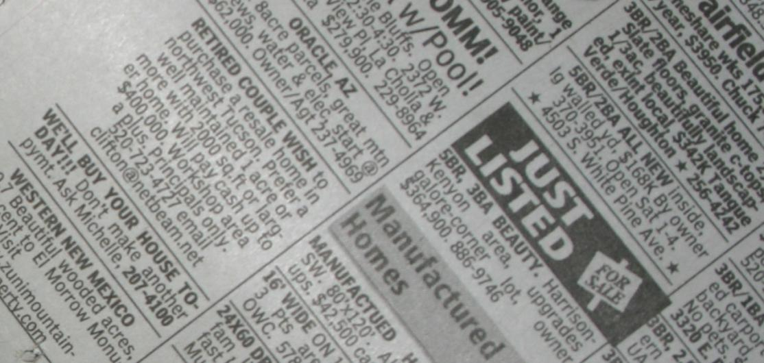 Vintahe newspaper classified ad pages listing homes for sale