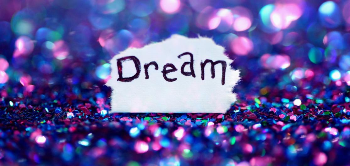 "The word ""Dream"" on a colorful background"
