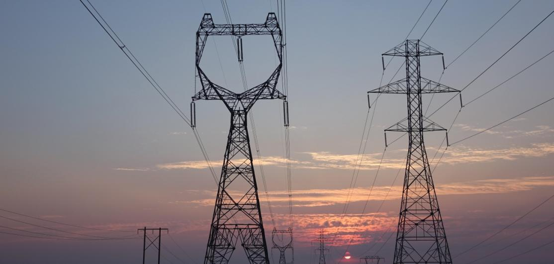 Power transmission lines in a field