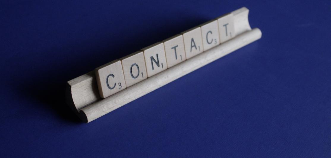 "The word ""Contact"" spelled out in letter tiles"
