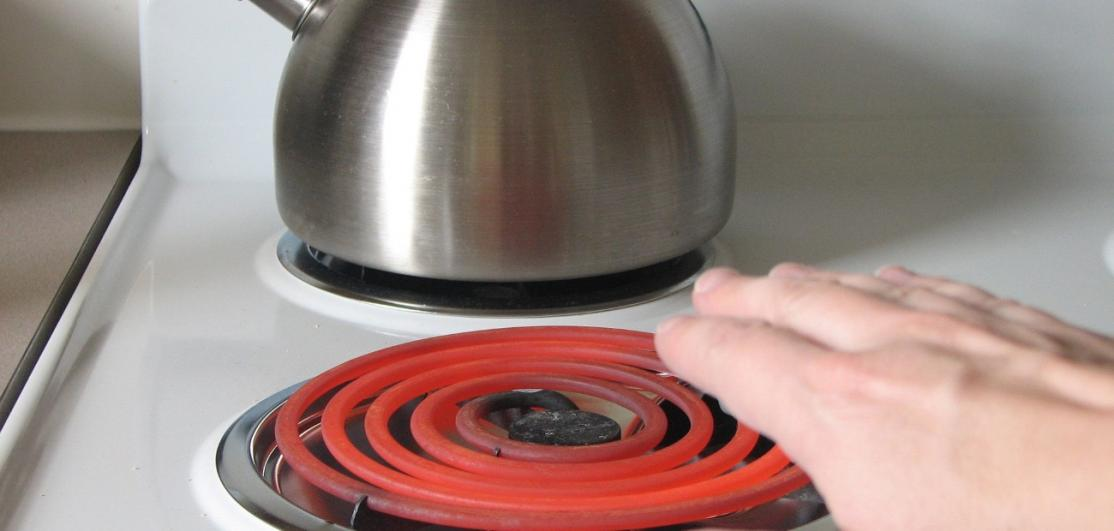 An old-fashioned coil heater on an electric stove
