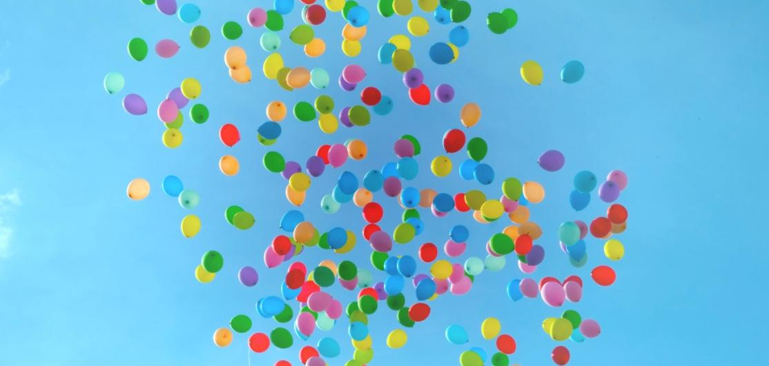 Colorful balloons floating freely in the sky